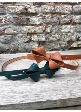 Shiny bow belt