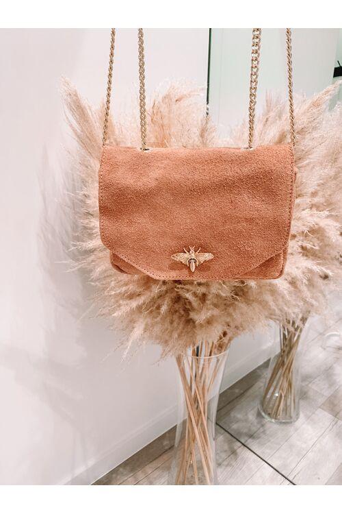 Daim bag gold detail